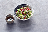 Tabbouleh with spring onions and pomegranate seeds
