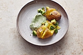 Baked potatoes with an avocado and quark dip