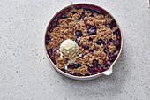 Sour cherry and poppyseed crumble with vanilla ice cream