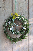 Rosemary wreath on a wooden wall