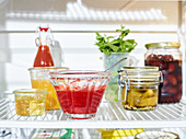 Pickles and preserves in a fridge