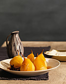 Glazed Poached Pears With Cinnamon Sticks