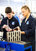 Engineering student working with an instructor