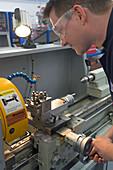 Student using a lathe