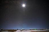 Moon shining over ALMA radio telescope, Chile