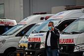 Man on phone outside hospital