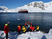 Landing party boarding zodiac in Orne Harbour, Antarctica