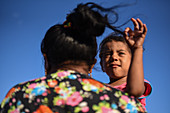 Wayuu indigenous mother holding daughter, Colombia