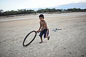 Wayuu indigenous child playing, Colombia