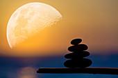 Zen stones in front of Moon
