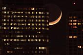 Crescent Moon behind skyscrapers