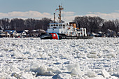 Icebreakers on St Clair River, Michigan, USA