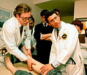 Anthony Fauci examining a patient during early AIDS epidemic