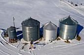 Grain storage bins in winter, aerial photograph
