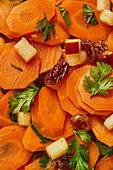 Warm carrot salad with apples, coriander and raisins