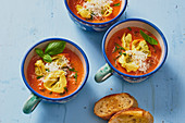 Cream of tomato soup with tortellini