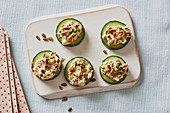 Cucumber canapés with cream cheese and dried tomatoes