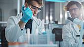 Research scientist using micro pipette
