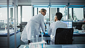 Team of scientists work in a laboratory