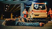 Man lying on the pavement after traffic accident