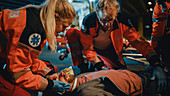 Team of paramedics providing medical help