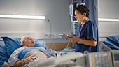 Nurse checking on elderly patient
