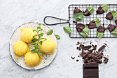 Vegan honeydew melon sorbet and mint leaves with chocolate coating