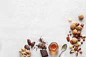 Various vegan ingredients for sweet dishes - spices, chocolate, agave syrup, dates
