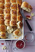 Sweet bread rolls on a baking sheet