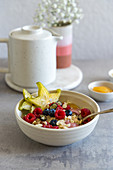 Oatmeal Breakfast Bowl with Fruits, Berries, Rubi Chocolate and Nuts
