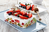 Jelly yoghurt dessert with colorful jellies and fresh fruits