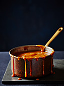 Caramel sauce in a copper pot