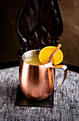 Mule with orange served in a traditional copper mug