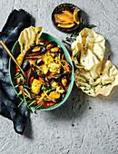 Curry mit Fisch, Muscheln und  eingemachten Zitronen (Kapmalaien)
