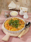 Sweet potato casserole with pecorino cheese and fresh rocket