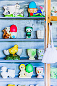 Colletion of funny egg cups in shelf