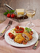 Stuffed veal piccata with tomatoes and mozzarella