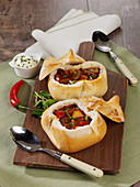 Hungarian style goulash soup served in bread rolls