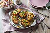 Loaded potato skins with cheese and spring onions