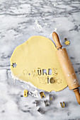 Rolled out shortcrust pastry with cut-out lettering