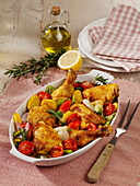 Baked chicken with potatoes and Mediterranean vegetables
