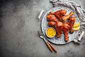 Tandoori chicken legs served with exotic yellow sauce and lemon wedges