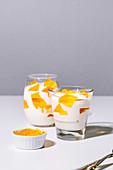 Tangerine mosaic jelly dessert in glasses
