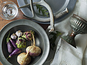 Turnips, Fairy Tale Eggplants, Artichokes and Garlic in Pewter Bowl