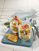 Layered salad with corn, celery, chicken breast and pineapple