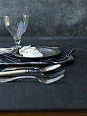 Whipped Cream Dollop on Pewter Plate With Cutlery, Napkin and Wine Glass