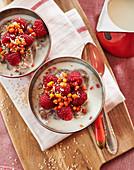 Buckwheat porridge with raspberries and sea buckthorn berries