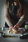 Girl kneading dough
