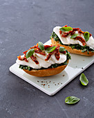 Mozzarella baguette with spinach, dried tomatoes and basil