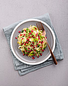 Sauerkraut salad with leek, honey and pomegranate seeds
